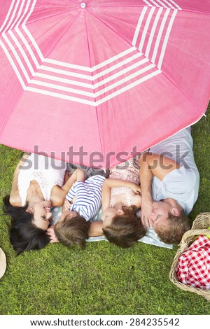 Overhead View Of Family Enjoying Picnic Together - stock photo