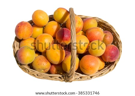 overhead view of fresh apricots in the straw basket