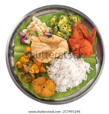 Overhead view of full length Indian mixed rice isolated on white background. - stock photo
