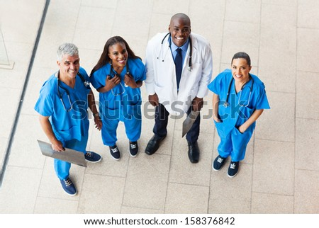 overhead view of group healthcare workers looking up - stock photo