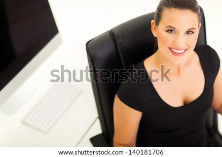 overhead view of happy businesswoman in office