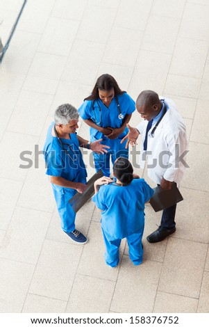 overhead view of medical workers having a meeting at hospital - stock photo