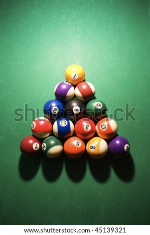 Overhead view of racked pool balls on pool table. Vertical shot.
