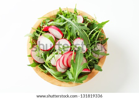 overhead view of salad with arugula and radish - stock photo