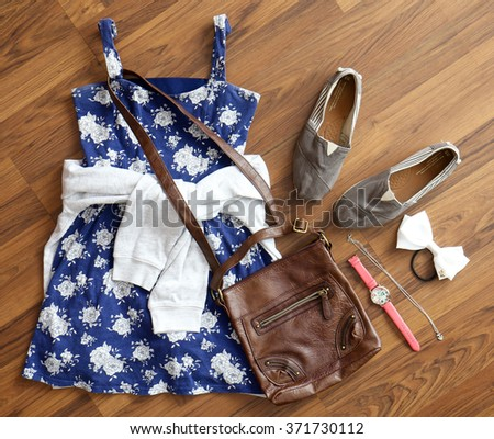 Overhead view of women's/girl's fashion with accessories. - stock photo