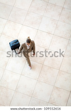 overhead view of young woman walking at airport - stock photo