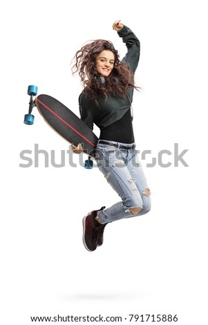 Overjoyed teen girl with a longboard jumping isolated on white background