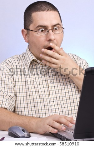 Overload businessman with computer problem on blue background. - stock photo