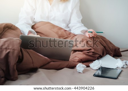 Overload-Overworked and tired sleeping over a laptop in a desk at work in her office home - stock photo