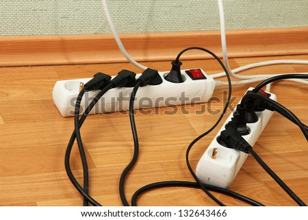Overloaded power boards, close up - stock photo