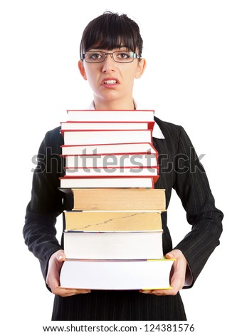 Overloaded sad teacher with a tower of books in her hands looking to the camera isolated on white - part of a series.