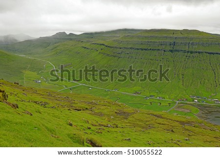 Overlook of a quiet valley landscape on the island of Streymoy in the Faroe Islands, which are located midway between Iceland and Northwestern Scotland, United Kingdom