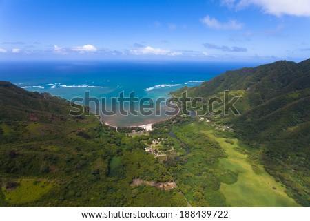 Overlooking Hawaii's lush green rainforests and waterfalls - stock photo