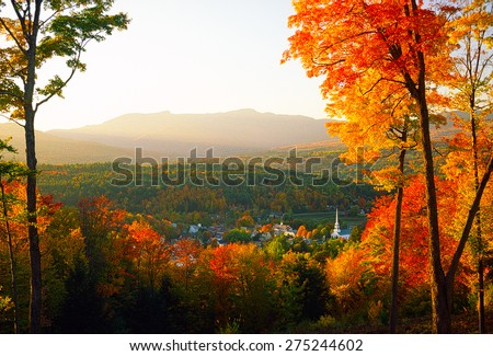 Overlooking Stowe Community Church sitting amongst the tranquil village of Stowe on a spectacular autumn sunset with Mt. Mansfield in the background, Stowe, VT, USA. - stock photo