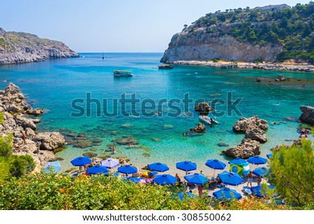 Overlooking the beautiful beach at Anthony Quinn Bay Rhodes Greece Europe - stock photo