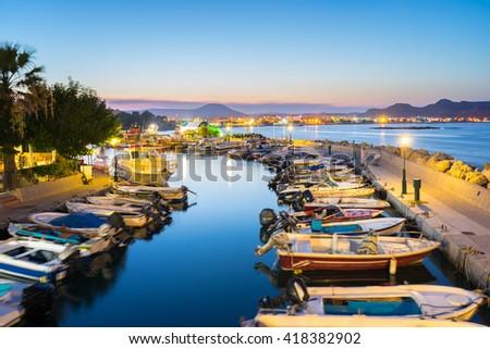 Overlooking the harbour at night. Faliraki Rhodes Dodecanese Greece Europe - stock photo