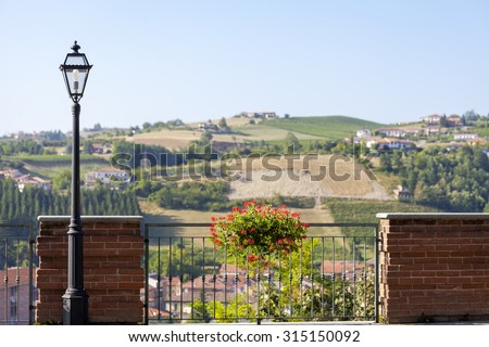 Overlooking the hills and vineyards of Barolo of the Langhe (Piedmont, Northern Italy), from the viewpoint of the town of Dogliani (Cuneo Province). La Morra (Cuneo), July 2015. - stock photo
