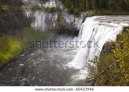 Overlooking the mists of the Mesa Falls waterfall in Idaho - stock photo