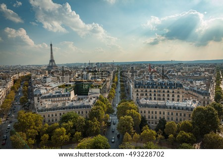 overlooking the street and the Eiffel Tower in Paris from the arc de triumph