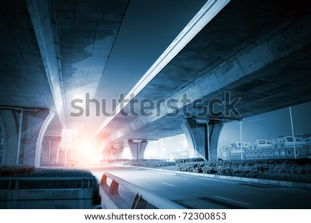 Overpass at night, heavy traffic.