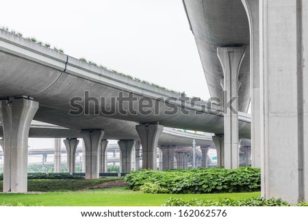 overpass bridge, low angle view at shanghai china. - stock photo