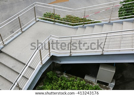 Overpass walkway with railing of stair to down