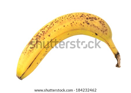 Overripe banana with spotty skin, isolated on a white background