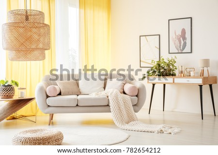 beige sofas living room. Oversize lamp in light living room with yellow drapes  beige sofa and knit blanket Lamp Light Living Room Yellow Stock Photo Image Royalty