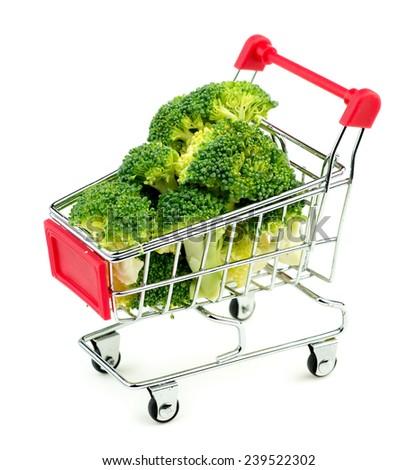 Oversized broccoli in shopping cart - stock photo