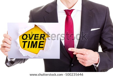 Overtime - Businessman Holding paper with word overtime