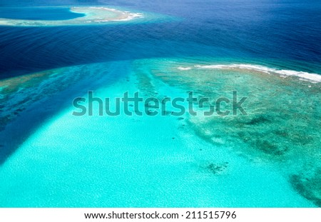 Overview from air over one of isolated island in Maldives region - stock photo