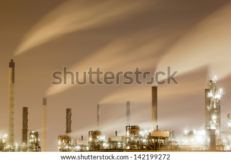 Overview of a large oil-refinery plant at night - stock photo