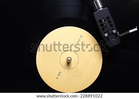 Overview of a vinyl record playing. Yellow label, side B (LP Lado B) - stock photo