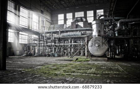 Overview of an old machine room at an abandoned energy plant, good days are over... - stock photo
