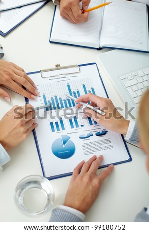 Overview of business team discussing the results of the work - stock photo