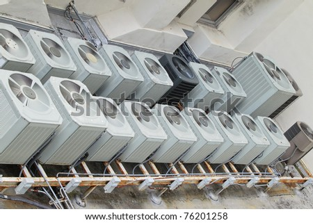 Overview of multiple air conditioning units on a roof top - stock photo