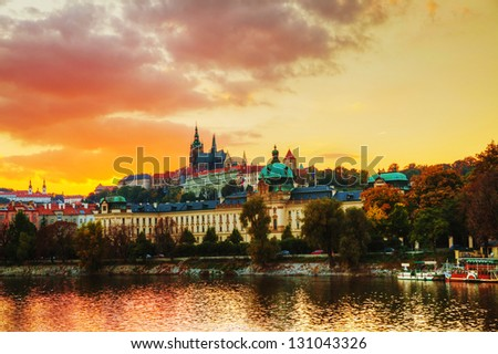 Overview of old Prague at sunset time - stock photo