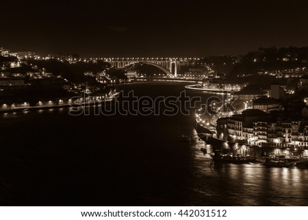 Overview of Old Town of Porto, Portugal at night. Ribeira and Douro river filtered in sepia - stock photo