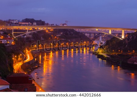 Overview of Porto, Portugal at night. Horizontal shot - stock photo