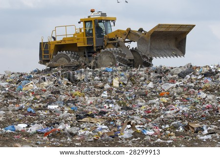 overview of refuse collection with bulldozer - stock photo