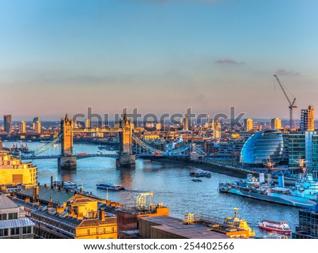 Overview of River Thames in Sunset in London. Tower Bridge and the City Hall in the Background - stock photo
