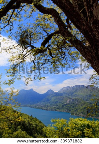 Overview of the south part of lake Annecy and mountains, at spring on morning. France - stock photo
