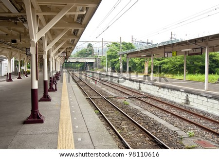 Overview of the tracks in a railway station - stock photo