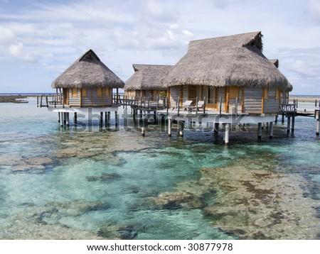 Overwater bungalow in Polynesia - stock photo