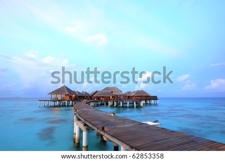 Overwater bungalows on the lagoon - stock photo