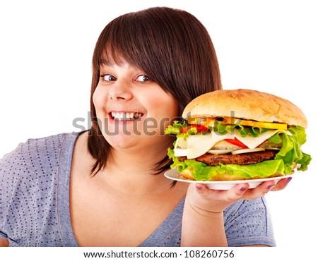 Overweight beautiful woman eating hamburger. Isolated. - stock photo