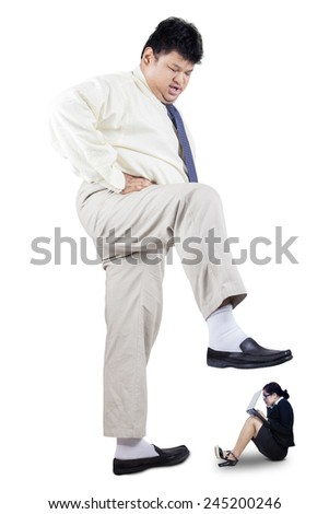 Overweight businessman stepping his foot to crush female worker, isolated on white - stock photo