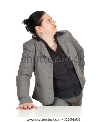 overweight, fat businesswoman in grey suit looking in side