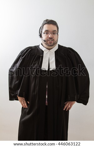 Overweight man in canadian lawyer toga talking into a headset  - stock photo