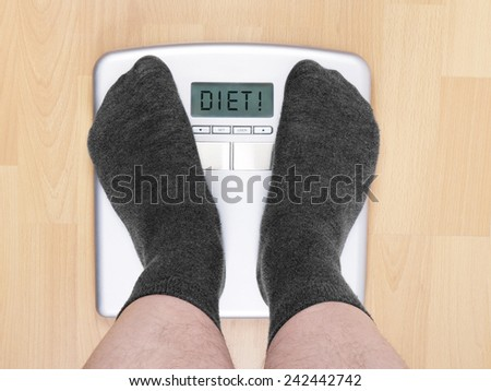 overweight man needs to go on a diet - stock photo